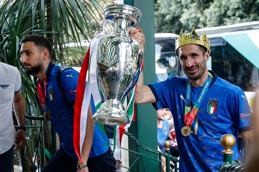 Italy captain Giorgio Chiellini carries the European Championship trophy as they arrive in Rome, Italy, on June 12, 2021.