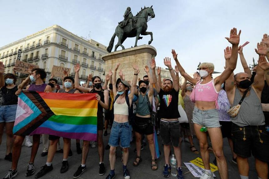 People protest against LGTBI-phobia at the Puerta del Sol square in Madrid, on July 11, 2021.