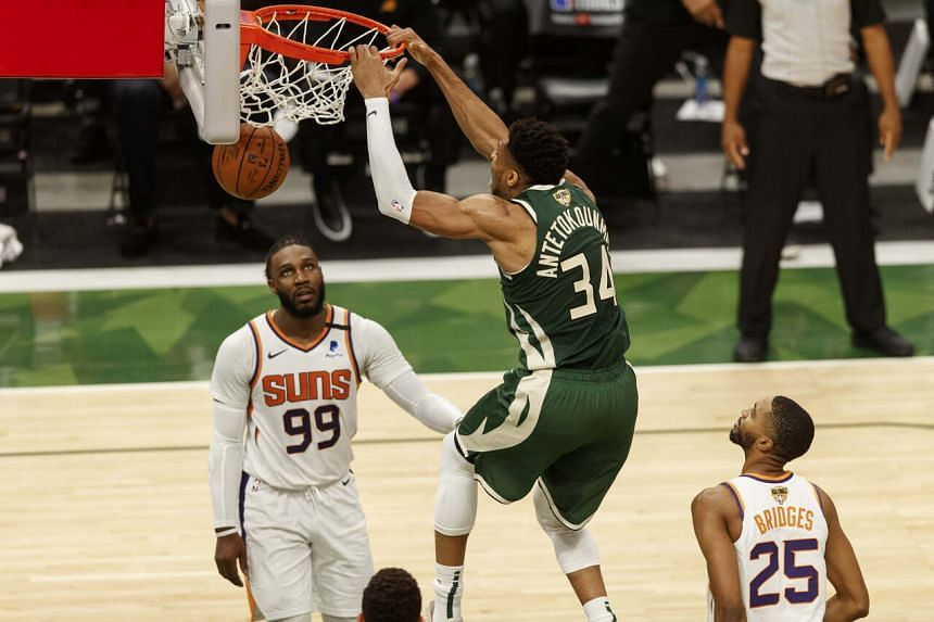 Milwaukee Bucks forward Giannis Antetokounmpo (centre) dunking the ball during the NBA Finals match against the Phoenix Suns on July 11, 2021.