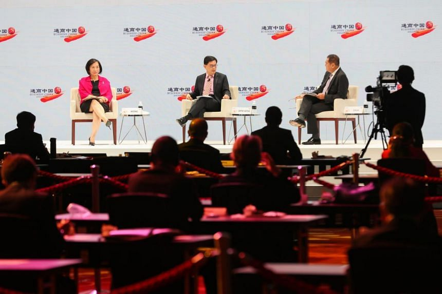 DPM Heng Swee Keat participating in the opening plenary dialogue session with moderator KK Chua (right) and panellist Helen Wong on July 12, 2021.
