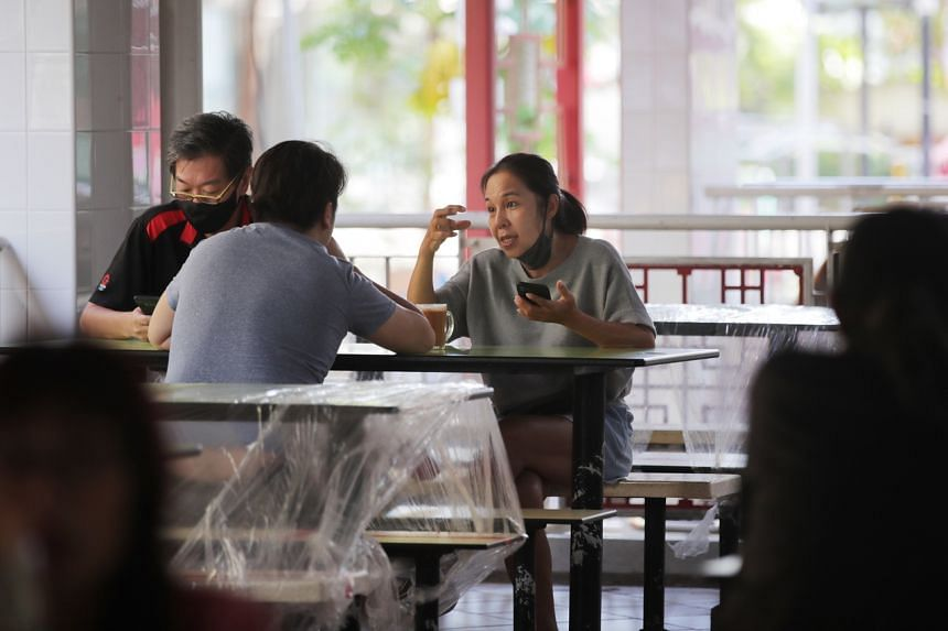 People having breakfast at Albert Centre market and food centre on July 12, 2021.
