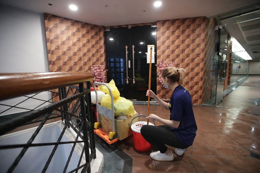 Cleaning staff at the common area outside Empress KTV at Tanglin Shopping Centre on July 13, 2021.