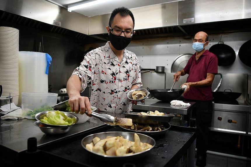 Mr Cedric Tang (left) helping out in the kitchen of his restaurant Ka-Soh in Greenwood Avenue.