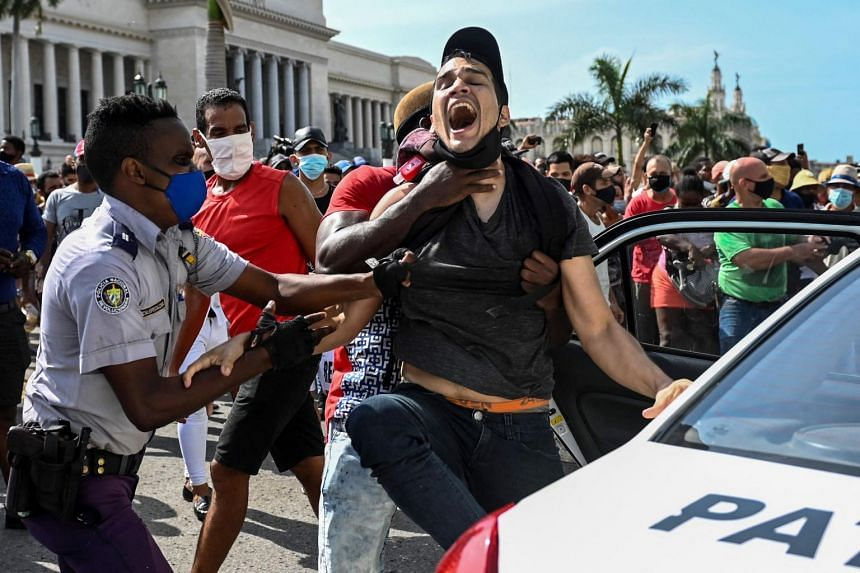 A man is arrested during anti-government demonstrations in Havana on July 11, 2021.