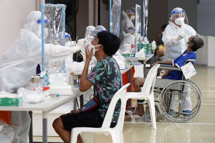 Long queues at testing facilities in Bangkok have caused a rethink of measures to track infections.