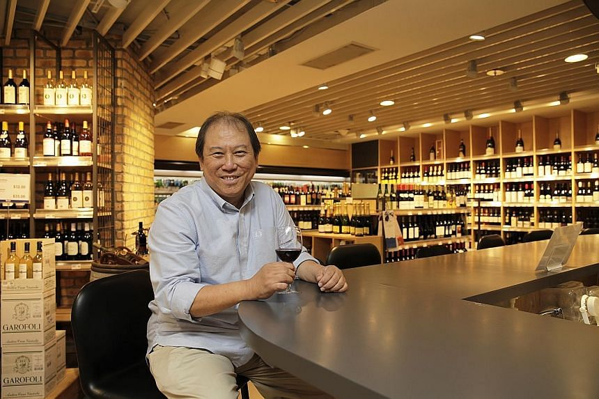 The late wine retailer Don Tay in August 2016 at his Bacchus outlet in the now-defunct Isetan department store at Westgate mall.