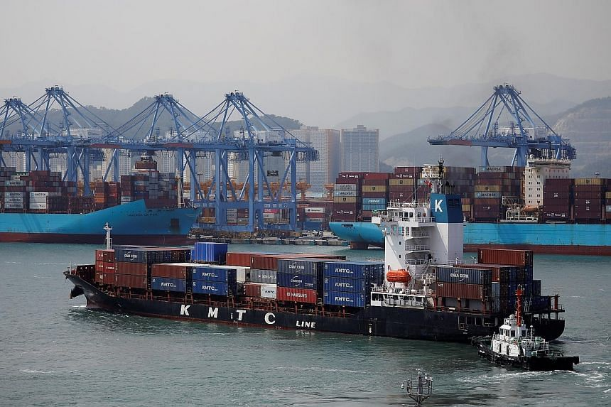 A container ship leaving Pusan Newport Terminal in Busan, South Korea, early this month. Infections on vessels could further harm already strained global supply chains, just as the United States and Europe recover and companies stock up for Christmas
