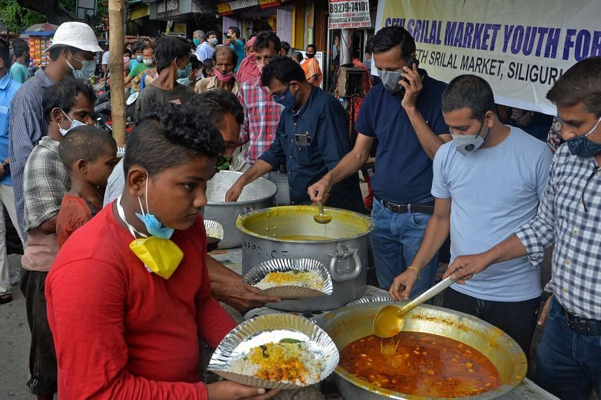 People at a free meal distribution in Siliguri, in India's West Bengal state.
