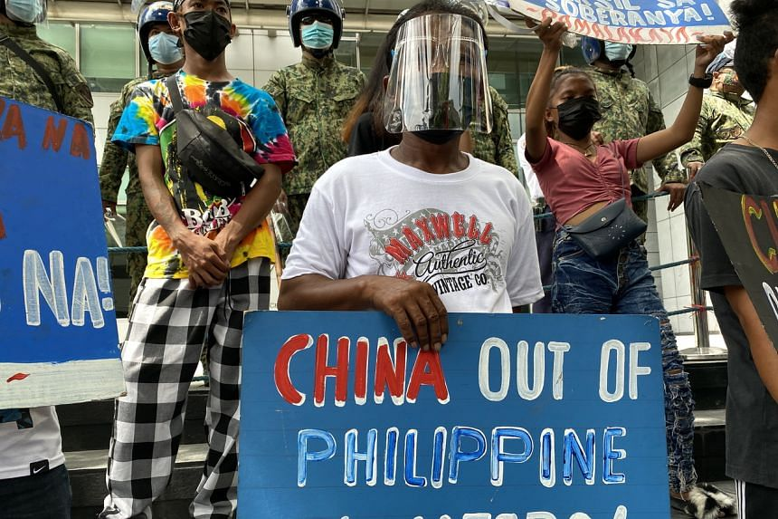 Filipino protesters demonstrating outside the Chinese consular office in Manila on July 12, 2021.