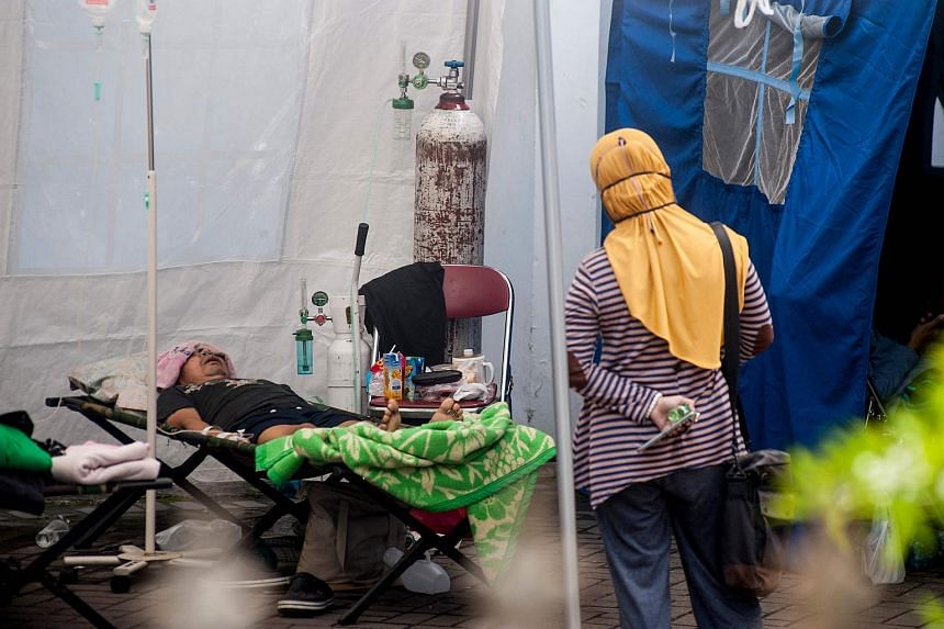 A Covid-19 patient receiving care under a tent in Yogyakarta, Indonesia, on July 13, 2021.