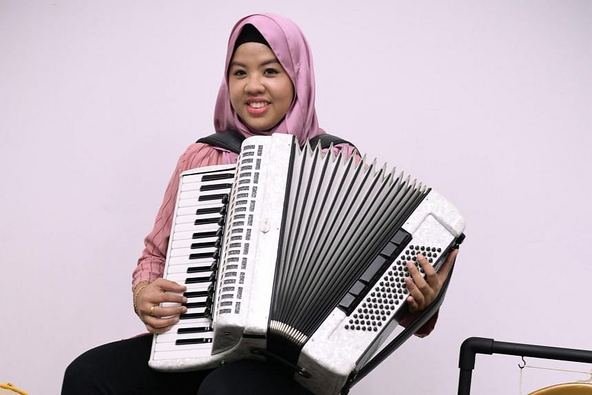 A self-taught accordionist, Syafiqah 'Adha Sallehin tinkered with her own melodies on the piano when she was a child.