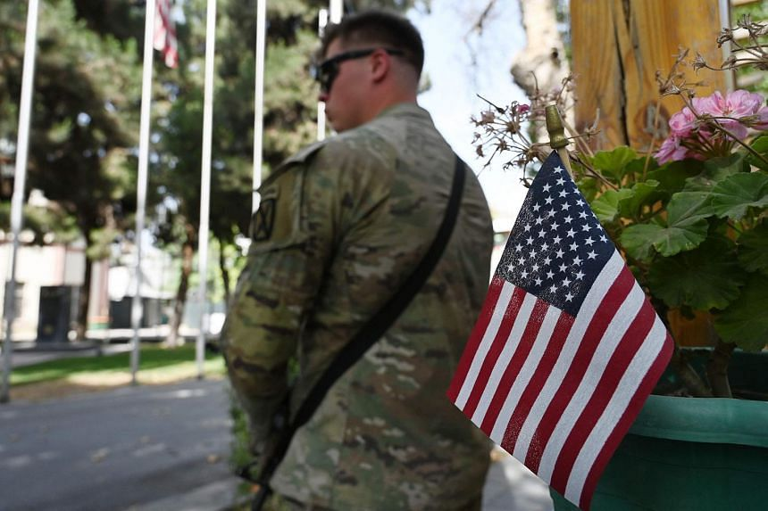 A member of the US military standing guard after an official ceremony in Kabul on July 12, 2021.