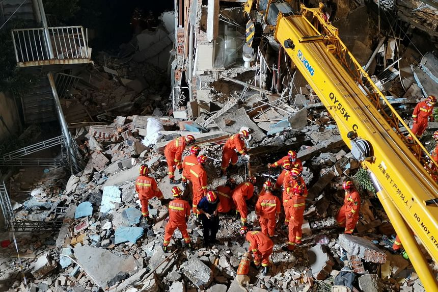 Rescue workers searching for people at the collapsed Siji Kaiyuan Hotel in Suzhou on July 12, 2021.