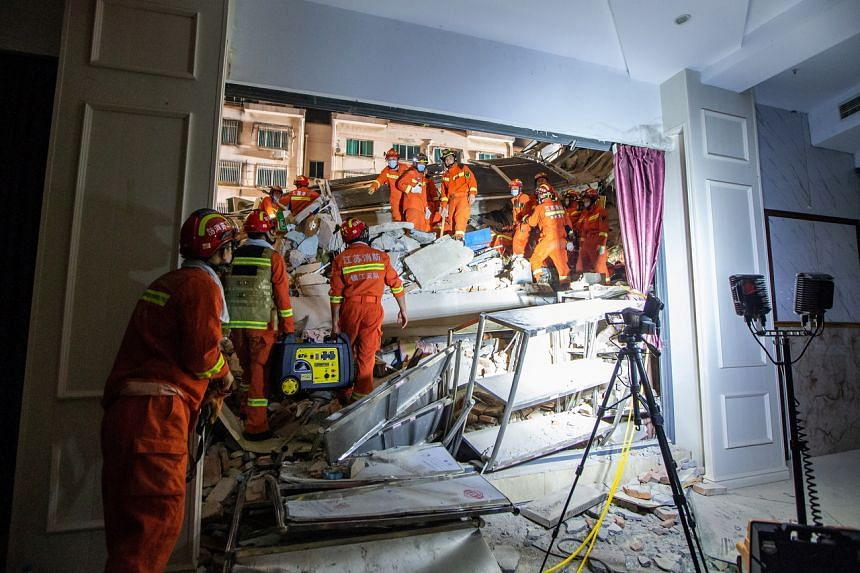 Rescuers working at the site of the partially collapsed Siji Kaiyuan Hotel in Suzhou on July 12, 2021.