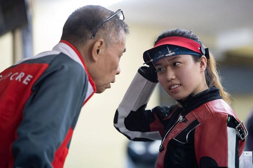 Adele Tan (right) with her coach Song Haiping.