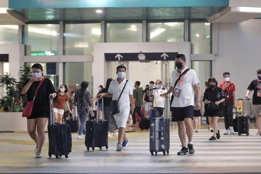 Passengers of Dream Cruises' World Dream ship leaving Marina Bay Cruise Centre, on July 14, 2021.