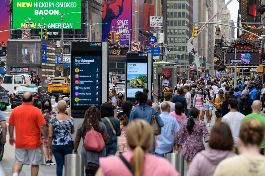 People walk through Times Square on July 13, 2021 in New York City.