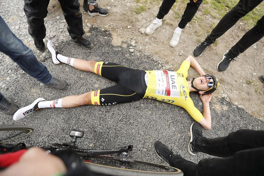 Tadej Pogacar celebrates after winning the 17th stage of the Tour de France.