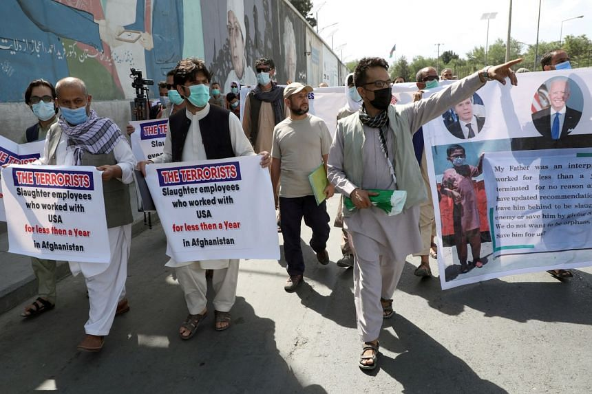 Former Afghan interpreters, who worked with US troops in Afghanistan, demonstrate in front of the US embassy in Kabul, on June 25, 2021.
