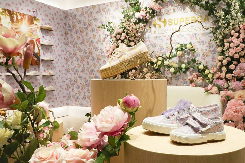 LoveShackFancy, features a collection of pastel floral shoes for women and children.