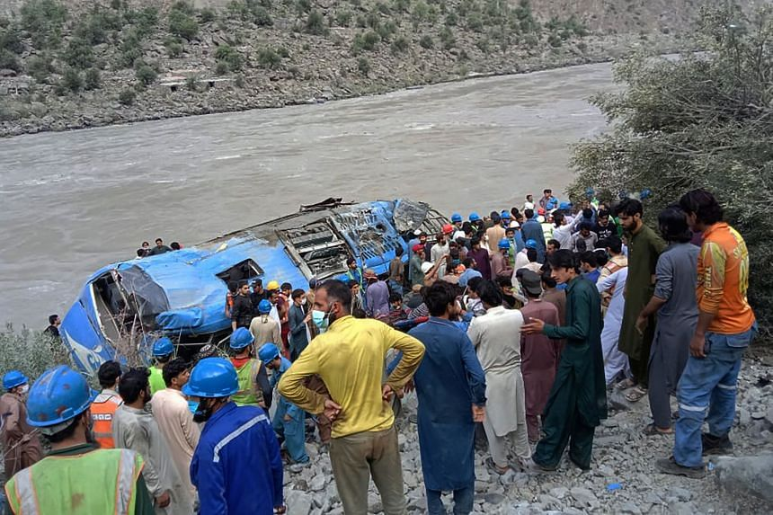A bus carrying 32 people exploded and plunged into a ravine in Pakistan's northern Kohistan region on July 14, 2021.