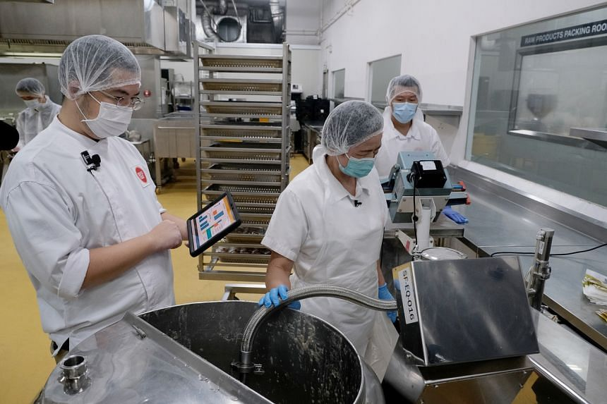 Mr Cai Ming. production manager of SouperFoods using his tablet to monitor the production.