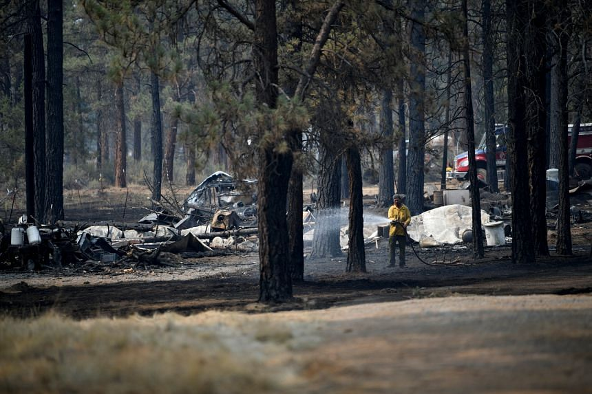 By morning, the so-called Bootleg fire had blackened more than 212,000 acres (85,793 hectares) and destroyed 21 homes.