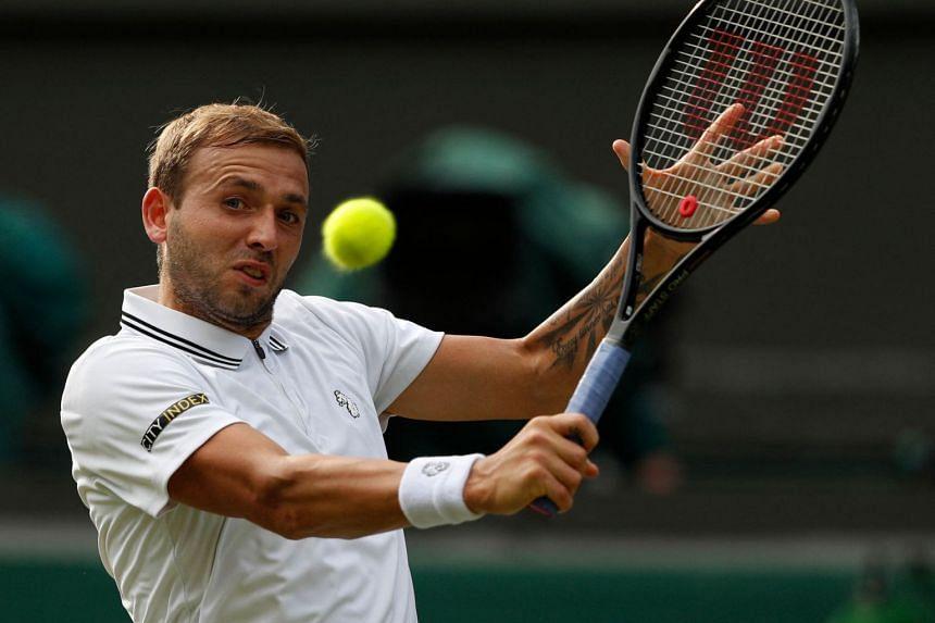 Britain's Dan Evans in action during Wimbledon.