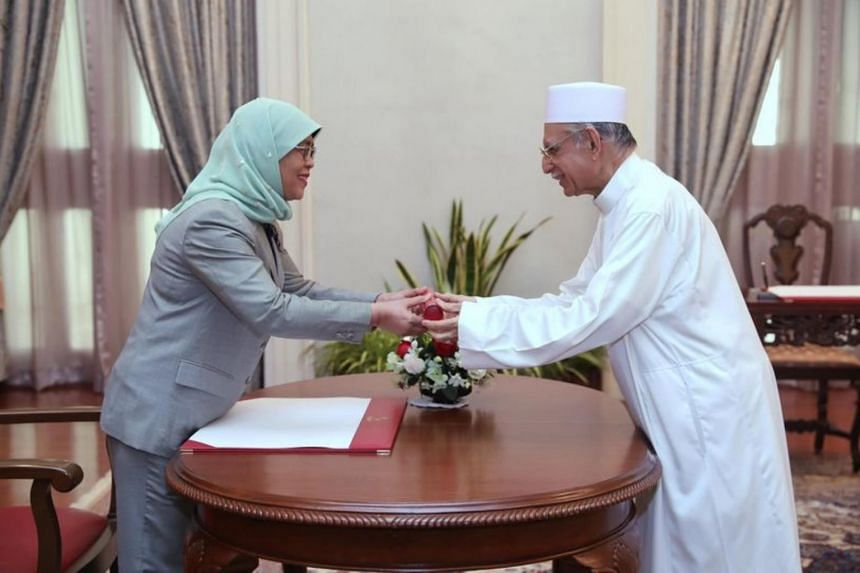President Halimah Yacob (left) officiated at the swearing-in and appointment ceremony of Imam Syed Hassan Al-Attas.