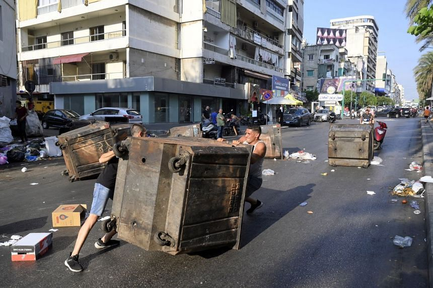 Protesters block the road with garbage bins after Lebanese Prime Minister-Designate Saad Hariri abandoned his effort to form a new government, in Beirut, Lebanon, on July 15,2021.