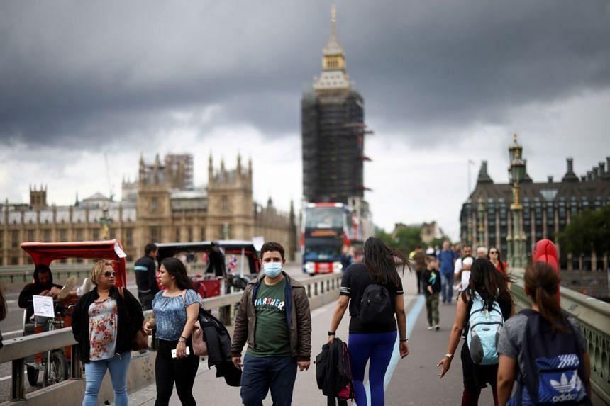 People walk over Westminster Bridge in London, Britain, on July 4, 2021.
