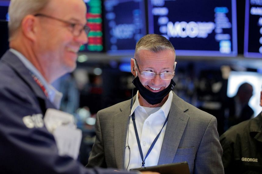 Traders work on the floor of the New York Stock Exchange in New York City, on July 15, 2021.