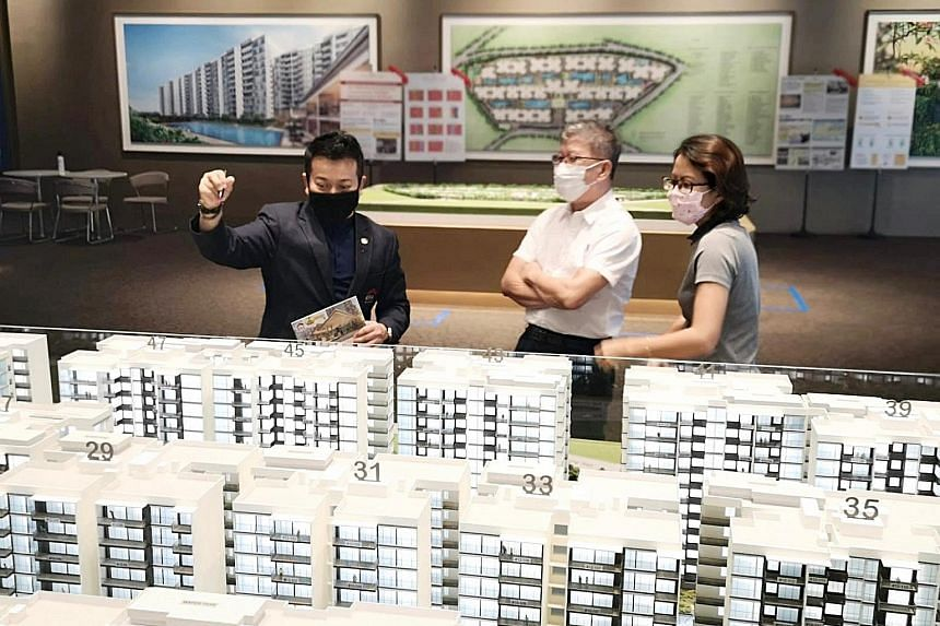 Visitors looking at a model of Treasure at Tampines, which was among the best-selling private home projects for last month. Developers sold 872 units in June, down 2.6 per cent from 895 units in May, according to the Urban Redevelopment Authority yes