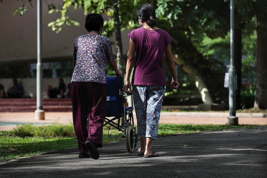 Employers with levy concessions - granted to those who live with Singaporean young children, the elderly or people with disabilities - will be prioritised under the pilot scheme, which involves an intensive testing regime. ST FILE PHOTO