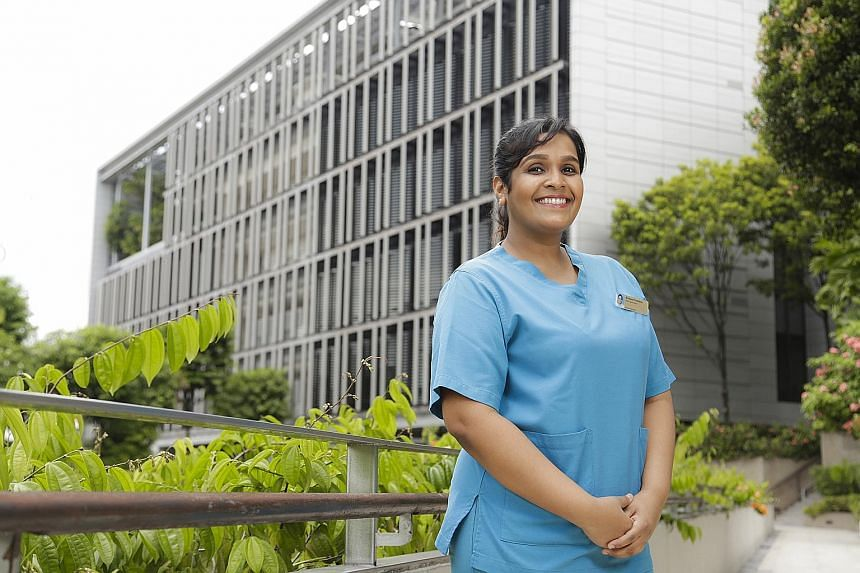 Khoo Teck Puat Hospital senior staff nurse Bindeeya Chandran earned a first-class degree while working on the front line of the Covid-19 pandemic and caring for her three-year-old son. KK Women's and Children's Hospital senior staff nurse Nurulhuda A
