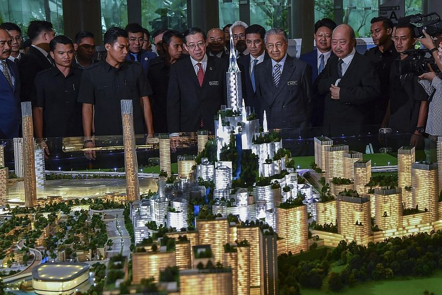 A 2019 photo of then Premier Mahathir Mohamad and other Malaysian officials looking at a model of the Bandar Malaysia development.