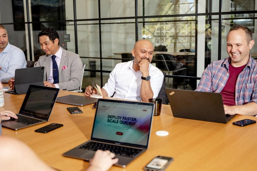 Chief executive of Akash Network Greg Osuri (centre) leads a meeting in his company in San Francisco, on July 8, 2021.