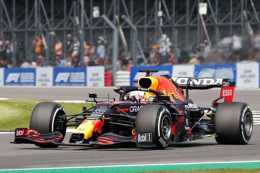 Verstappen drives at Becketts Corner during the first practice session ahead of the British grand prix.
