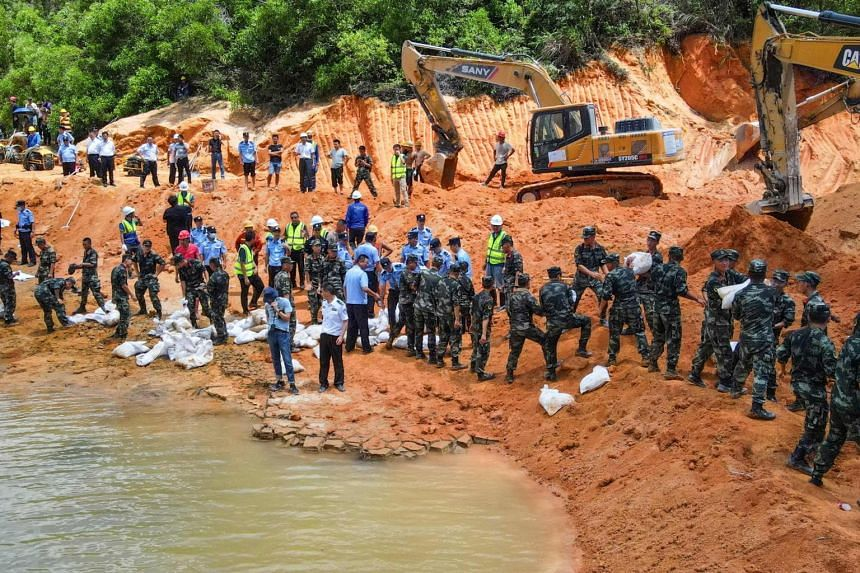 Paramilitary police officers working on a flooded tunnel after 14 workers were trapped in Zhuhai, in China's southern Guangdong province on July 15, 2021.