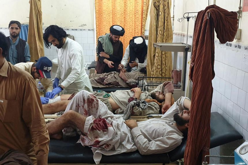 Paramedics treat men injured in Chaman, a Pakistani town in the border with Afghanistan, on July 16, 2021.