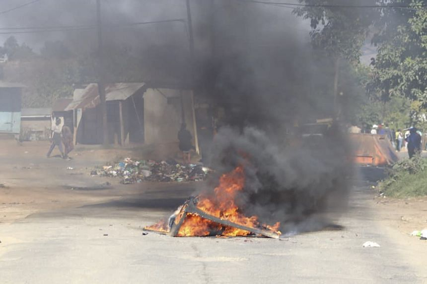 A photo from June 29, 2021, shows a barricade on fire in Mbabane, Eswatini.