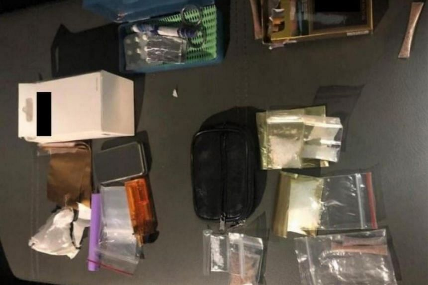 Packets and straws of heroin, Ice and various drug paraphernalia seized in the vicinity of Ang Mo Kio Ave 3 in a CNB operation, on July 14, 2021.