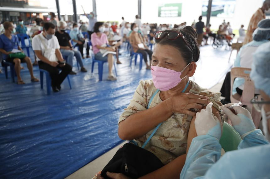 Thai health officials administer the AstraZeneca vaccine to people over 50 years of age in Bangkok, Thailand, on July 16, 2021.