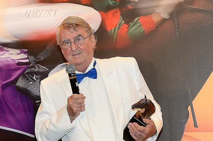 Laurie Laxon receiving his ninth Singapore Champion Trainer's Award in January 2015. It was for his premiership victory in 2014.