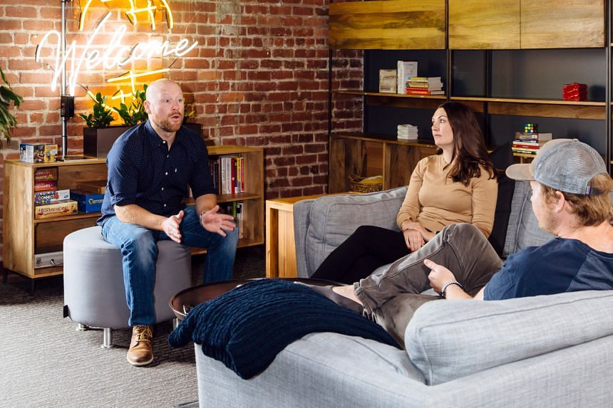 Employees at the San Francisco HQ of Envoy, a start-up whose latest product lets staff book desks for when they go into their company's workplace.