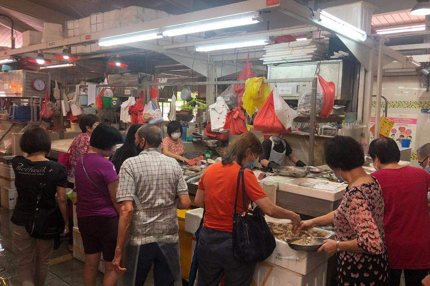 Patrons queueing at a seafood stall at Clementi 448 Market and Food Centre, around 11am on July 17, 2021.