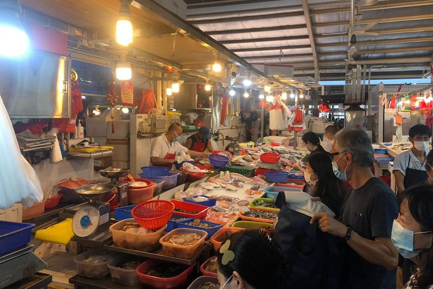 Customers at Ghim Moh Road Market and Food Centre rushing to buy fish on July 17, 2021.