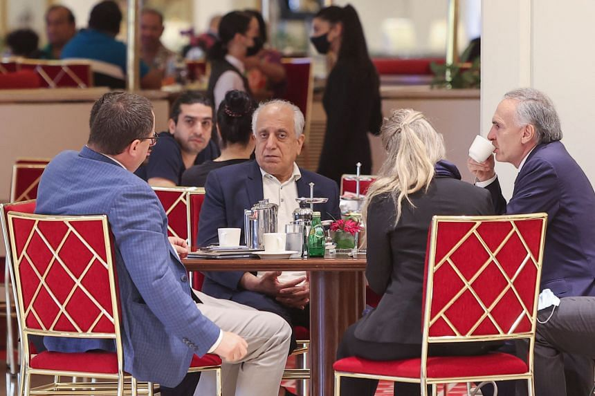 US Special Representative for Afghanistan's Reconciliation Zalmay Khalilzad (centre) seen before a session of peace talks between the Afghan government and the Taleban in Doha, on July 17, 2021.
