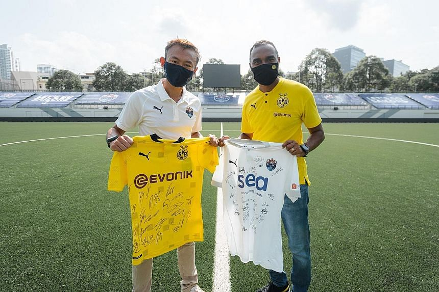 Lion City Sailors chief executive officer Chew Chun-Liang and Suresh Letchmanan, managing director of BVB Asia Pacific, commemorating the signing of the partnership of the two clubs. PHOTO: LION CITY SAILORS