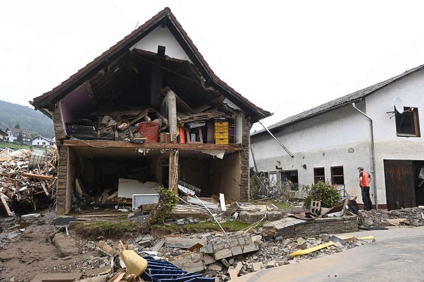 A man stands in front of a destroyed house after floods caused major damage in Schuld near Bad Neuenahr-Ahrweiler, western Germany, on July 17, 2021.